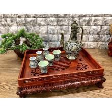 Bộ trà Bát Tràng khắc nổi hoa mẫu đơn tiên tửu
